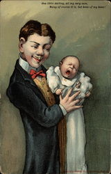 Man holding crying baby