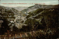 A Glympse of Deadwood and the White Rocks from C.u.N.W. Track to Lead