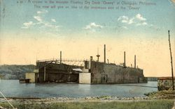 "A cruiser in the monster floating dry dock ""Dewey"" Postcard"