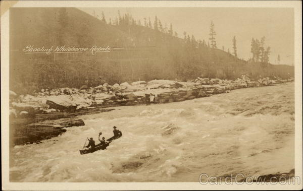 Shotting Whitehorse Rapids in a canoe YT Canada