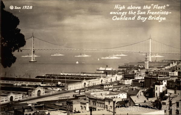 High above the Fleet swings the San Francisco-Oakland Bay Bridge California