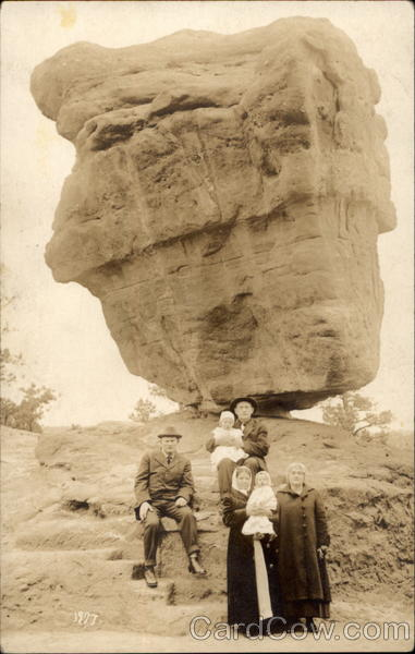 Family portrait in front of balancing rock Manitou Colorado