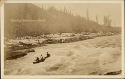 Shotting Whitehorse Rapids in a canoe