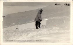 Eskimo Cutting Snow Blocks Postcard