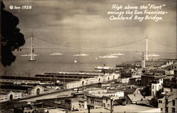 "High above the ""Fleet"" swings the San Francisco-Oakland Bay Bridge"