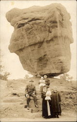 Family portrait in front of balancing rock