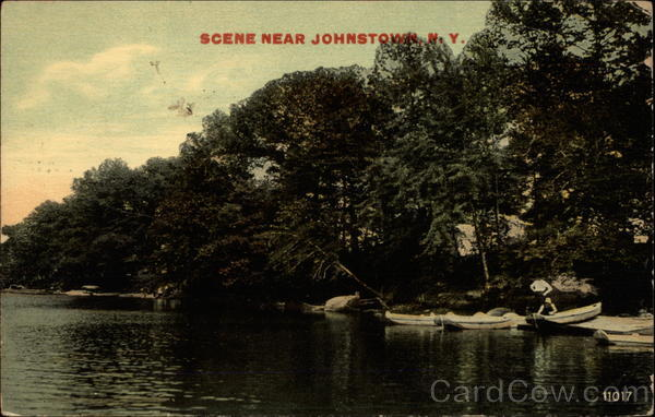 Lake side scene with canoes on shore Johnstown New York
