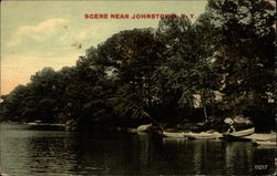 Lake side scene with canoes on shore
