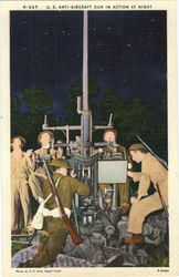 U. S. Anti-Aircraft Gun in Action at Night