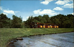 Pioneer Land Train along Lake Rudolph Postcard
