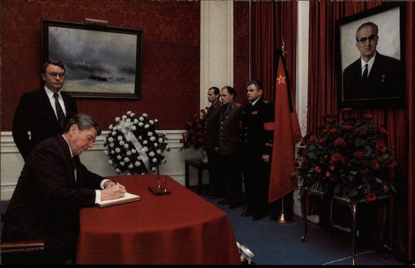 president reagan signing condolence book for yuri andropov