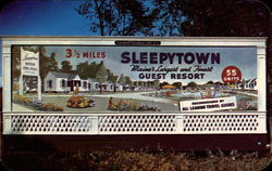 Signboard approaching Sleepytown Guest Resort