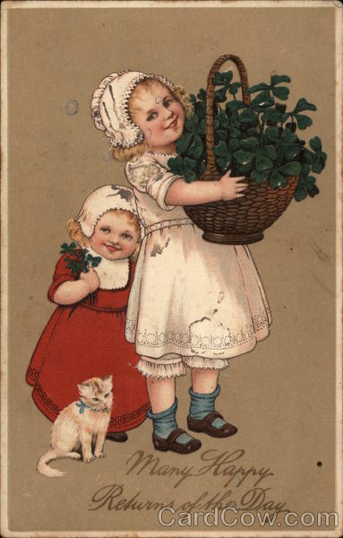 Two Girls with a Kitten and a Basket of Clovers