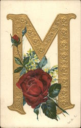 "Gold letter ""M"" and red rose"
