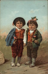 Two Boys Holding Flowers