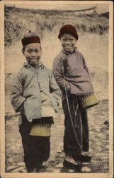 Two Oriental Boys Posing for Camera