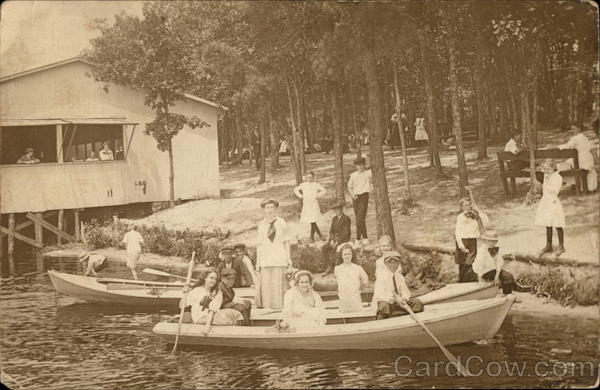 People in Rowboats Near Wooded Shore Canoes & Rowboats