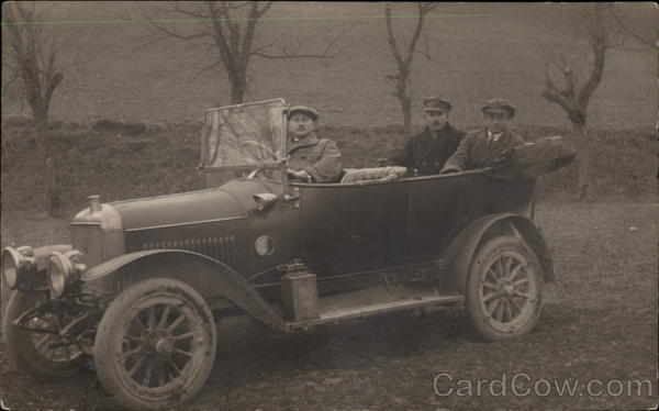 Three Men in an Early Automobile Cars