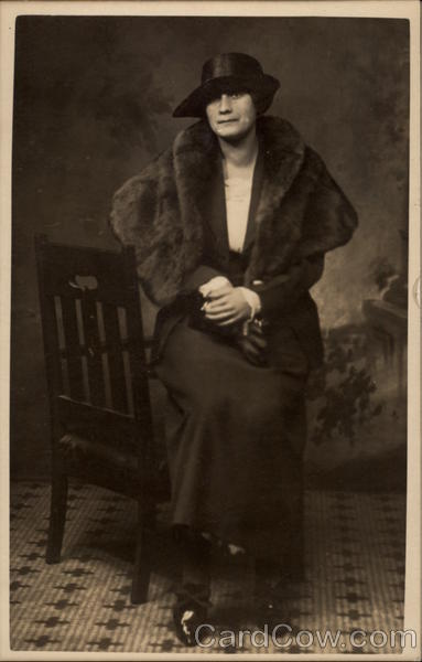 Seated Woman in Fur and a Hat Women