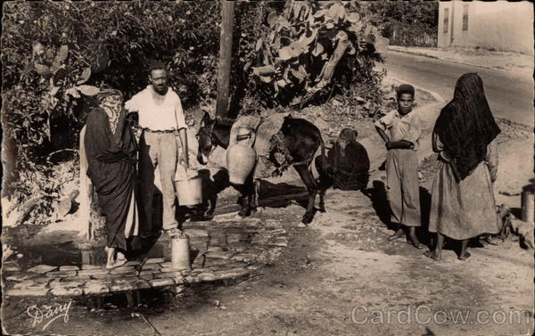 African scene of villagers getting water from well Tunsia