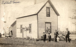 Family in Front of Home Postcard