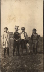 Four Children in Costumes