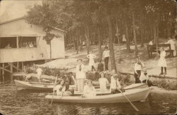 People in Rowboats Near Wooded Shore