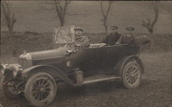 Three Men in an Early Automobile