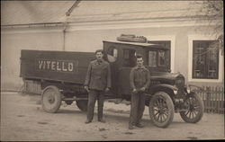 Two Men in Front of Delivery Truck