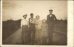 Family Standing on the Train Tracks
