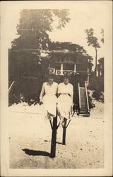 Two Women in Front of Beach Home
