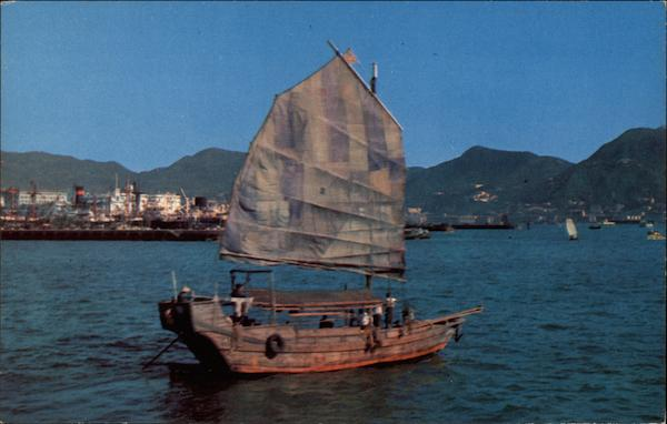 Small Cargo Junk sails across Victoria Harbour Hong Kong
