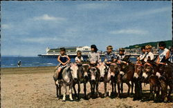 Children Riding Donkeys on Beach