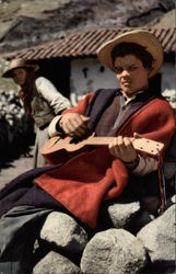 An Andean Villager Plays His Instrument