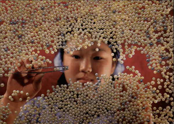 Woman Sorting Pearls Asian