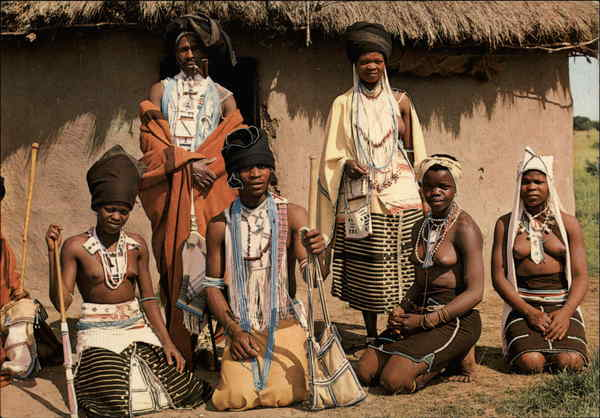 Pondo Men and Women in Tribal Dress South Africa: https://www.cardcow.com/282702/pondo-men-women-tribal-dress-africa