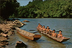 Nude Sea Dayak Beauties Rowing Canoe on the River