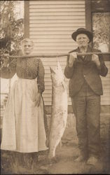 Old Couple Holding Caught Fish