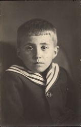 Young Boy with a Striped Collar