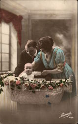 Parents Admire Their New Baby in Her Bassinet
