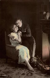 Couple in Chair Before Fire