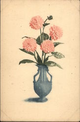 four pink carnations in a blue vase