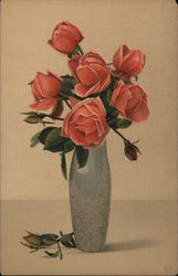 Pink roses in tall olive green vase