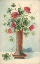 Flowers and clover in a vase