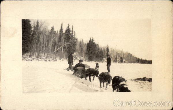 Men With Dogsled Team Canada