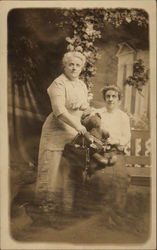 Two Women with a Teddy Bear