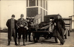 Four Men With Dead Moose in the Back of a Truck