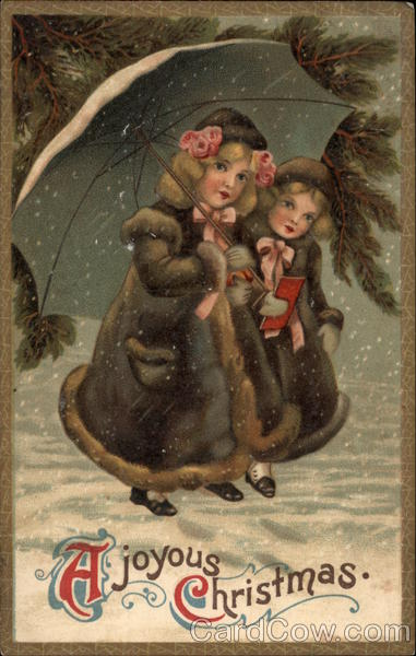 Two girls in coars holding umbrella and standing in the snow