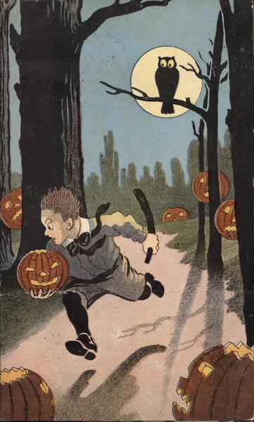 Boy in woods with Jack-O-Lantern Halloween