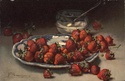 Strawberries on a blue pattern plate with sugar bowl